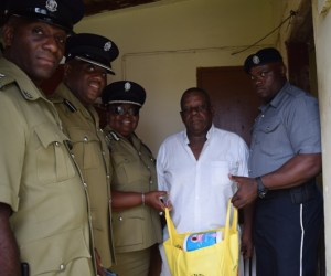 Mr Francis receiving gift from Police and Police Sports club