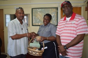 Officer on Duty at the Sandy Point Police station surpised by Commissioner Queeley bearing a Christmas Treat.