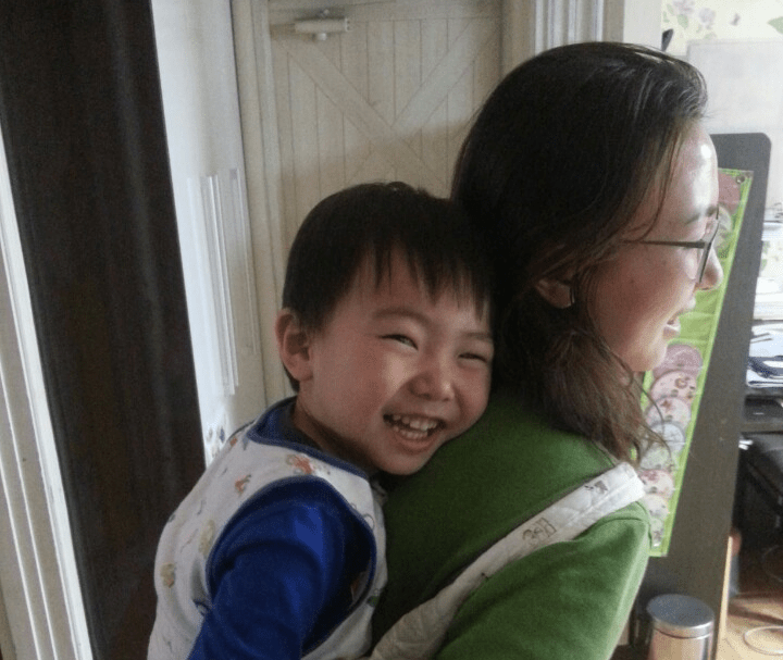 Photo of boy on mother's back