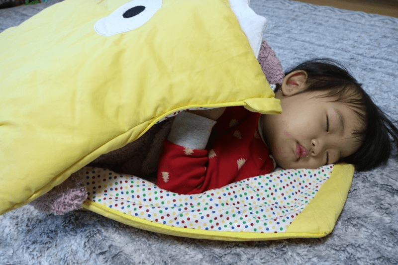 Photo of the boy with the yellow blanket