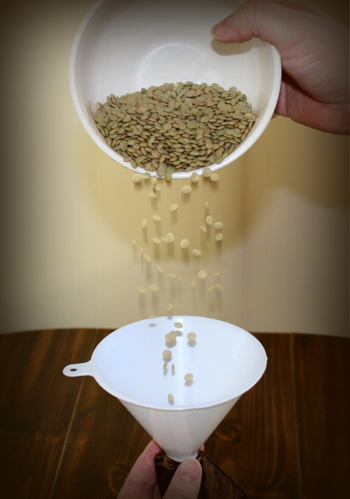 pouring lentils into a therapy pillow