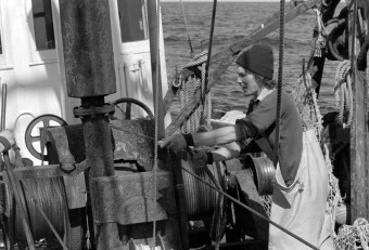 """Fisherman Paul Hirth operating winch to lower """"otter doors"""" which will spread the net on the ocean floor. Photo by Joseph Thomas"""