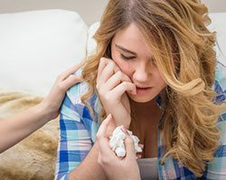 hands-of-mother-consoling-sad-teen-daughter-crying