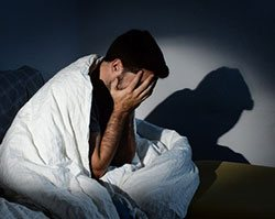 young-man-suffering-depression-xs