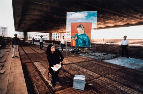 "In 1968, Lina Bo Bardi, 54, at the MASP construction site with Van Gogh's ""The Postman's Son"", 1888, on her signature Arte Povera easel/Photo: MASP"