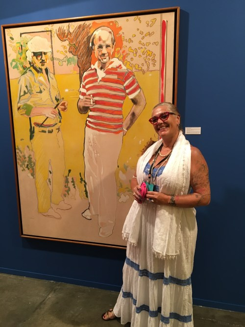 Patricia Lee in front of her uncle's art