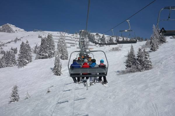 Family on the ski lift going up the mountain