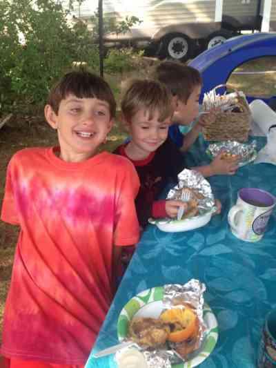 Enjoying Camp Cinnamon Rolls cooked in Oranges