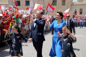 epa06011823 Joseph Muscat (C-L), leader of the Partit Laburista (Labour Party) and Maltese Prime Minister, his wife Michelle Muscat (C-R) and and twin daughters Etoile and Solie Sophie wave to the crowd before entering the Auberge de Castille, after he was sworn-in as Prime Minister in Valletta, Malta, 05 June 2017. Muscat's party won the 03 June election with a 55.1 per cent majority. EPA/DOMENIC AQUILINA