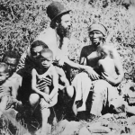 A Christian missionary with a group of Africans in the Transvaal region of South Africa, 1864. Photo by Hulton Archive/Getty Images.