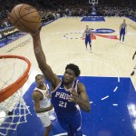 27 November 2017: Cameroonian Joel Embiid of the Philadelphia 76ers dunks the ball against the Cleveland Cavaliers at the Wells Fargo Center in Philadelphia. (Photograph by Mitcell Leff/Getty Images)