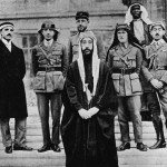 22 January 1919: Emir Feisal at the Palace of Versailles during the Paris Peace Conference. Behind him, left to right, are Rustin Day, Nuri Es-Sa'id, Pisani, Lawrence, Haidar of Baalbek and Hassan Dey Qadri. (Photograph by Hulton Archive/Getty Images)