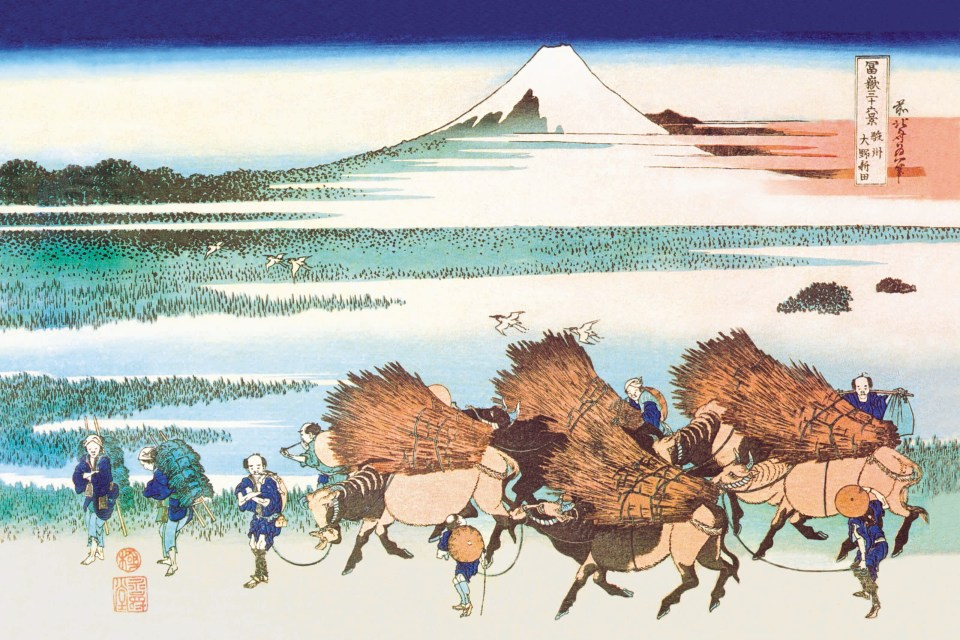 Circa 1831: This scene of everyday life depicts farmers leading pack animals carrying thatching straw against the backdrop of Mount Fuji. It is a woodblock print by Katsushika Hokusai. (Supplied by Buyenlarge/Getty Images)