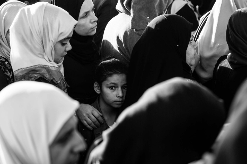 8 June 2018: A Palestinian girl is stuck in the crowd of worshippers passing the Qalandia checkpoint on the last Friday of Ramadan. Photograph: Anne Paq/activestills.org