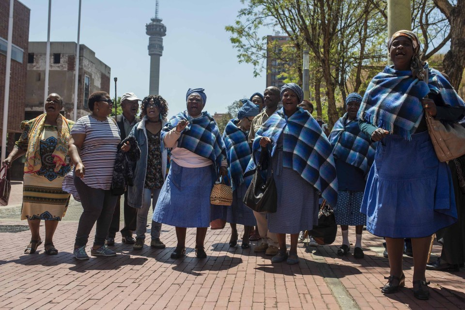 25 October 2018: Residents of the Lesetlheng village community from the North West celebrating outside the Constitutional Court after the court set aside the High Court interdict evicting them from their farming land.