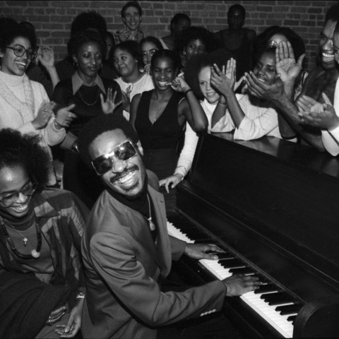 18 December 1976: American musician Stevie Wonder entertains students at the Dance Theatre of Harlem in New York, United States. (Photograph by Allan Tannenbaum/Getty Images)