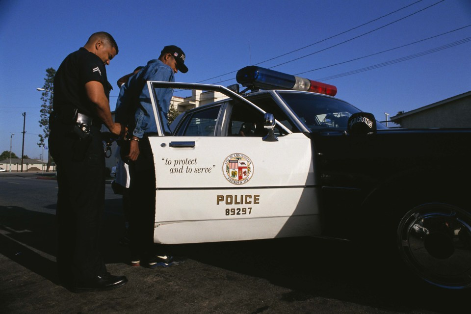 11 April 1993: Police on patrol in South Central Los Angeles, California, during jury deliberations for the second Rodney King trial. (Photograph by Mark Peterson/Corbis via Getty Images)
