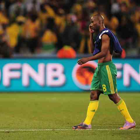 22 June 2010: Siyabonga Nomvethe looks dejected as South Africa win their Group A match against France in Bloemfontein but leave the 2010 Fifa World Cup competition. (Photograph by Clive Mason/Getty Images)