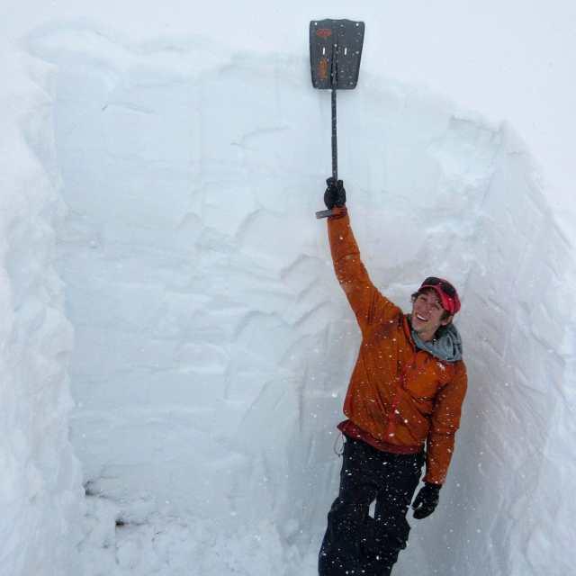 Excavating a deep snow pit.