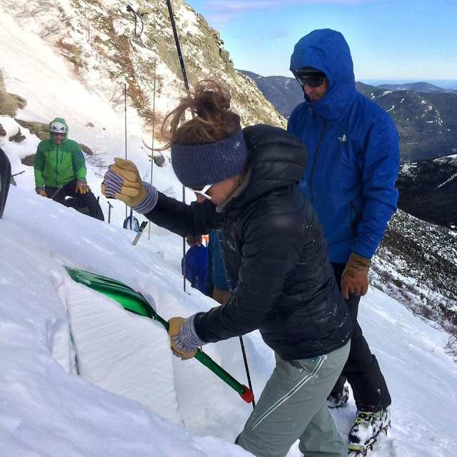 Evaluating the snowpack in Tuckerman Ravine on Mount Washington.