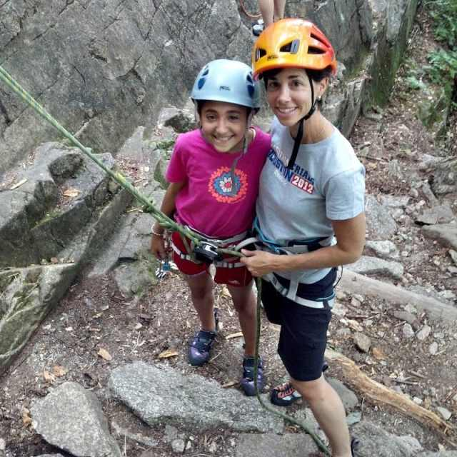 Family rock climbing instruction at Cathedral Ledge in North Conway, New Hampshire.