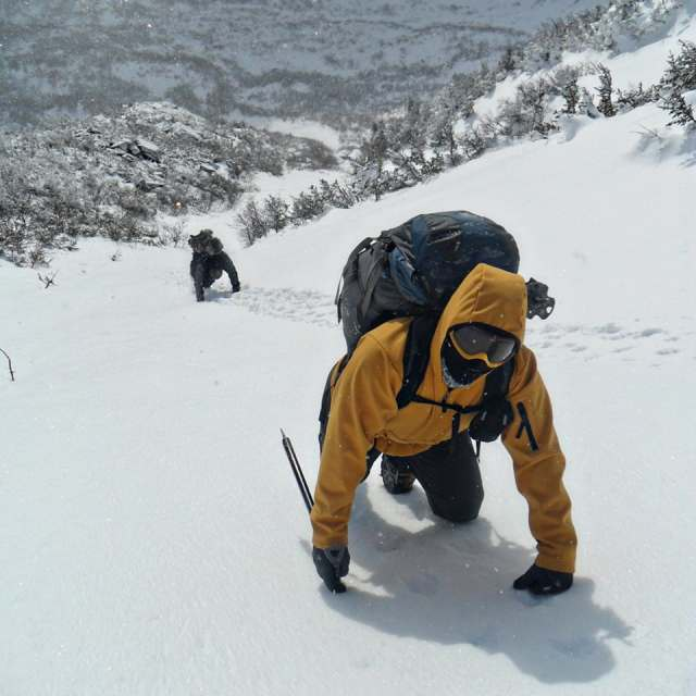 Climbing a snow gully in Tuckerman Ravine while heading towards the summit of Mount Washington, New Hampshire.