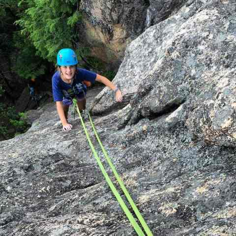 Youth rock climbing camp at Cathedral Ledge in North Conway, New Hampshire.