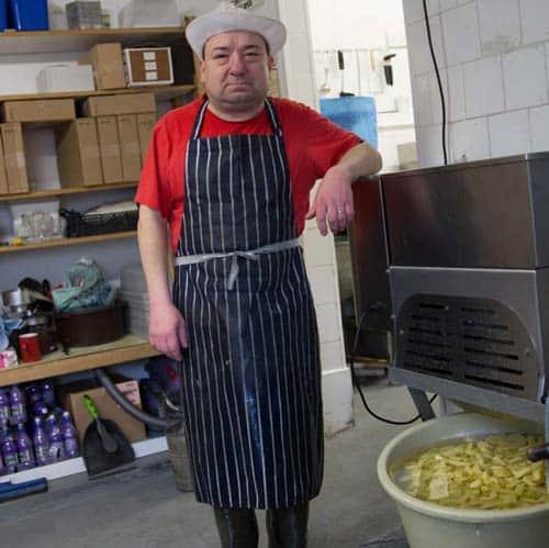 Paul, the chips maker at the Newington Fish Bar