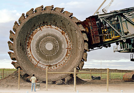 Man and machine: the scale of the project is mind-boggling. This 170 metre long bucket-wheel reclaimer is used to shift tar sands along conveyor belts.