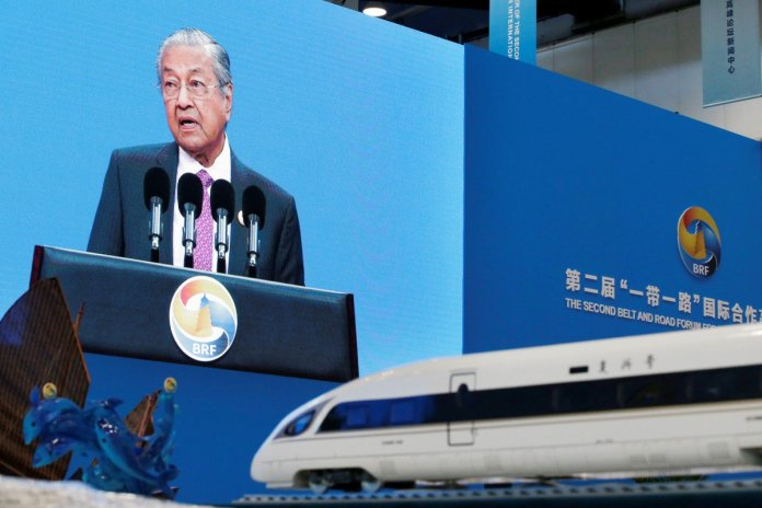 Mahathir Mohamad delivers a speech in April at the opening ceremony for the second Belt and Road Forum in Beijing, next to a replica of a China high-speed train. Photo: Reuters
