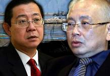 DAP's Lim Guan Eng and MCA's Dr Wee Ka Siong (right)
