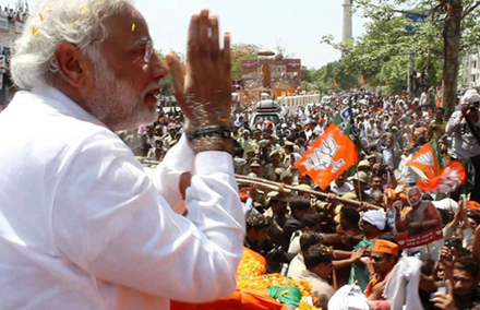 Narendra Modi waves to supporters.