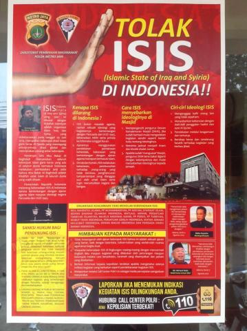 A poster hanging on the front door of a sub-district police station in central Jakarta, September 2014. Photo: Dominic Berger