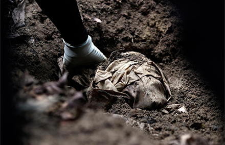 Human remains found in a mass grave at a human trafficking camp in Malaysia. Photo by Al Jazeera.