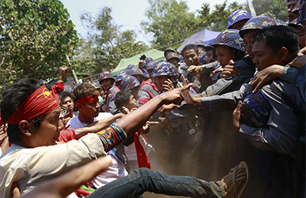 Police clash with student protestors in Myanmar. While new laws give the right to protest, people are still arrested for doing so. Photo by Reuters/Soe Zeya Tun.