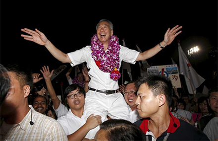 Lee Hsien Loong is carried on supporters' shoulders after claiming victory in Singapore's elections, Friday. Photo: Reuters.