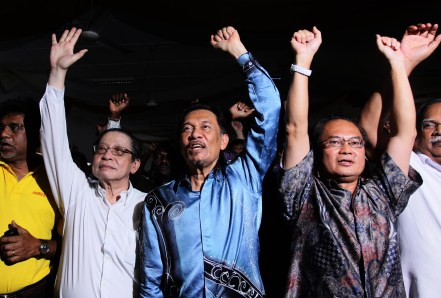 Lim Kit Siang (left) and Anwar Ibrahim (centre).