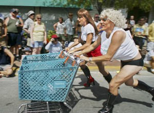 """A female impersonator, known as Gina Maseratti, left, and Gary """"Trampie"""" Drews, both of Key West, Fla., compete in the Conch Republic Drag Race in Key West."""