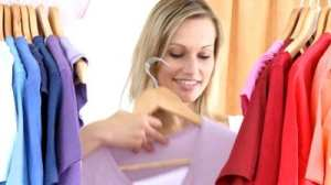 stock-footage-woman-shopping-for-t-shirts