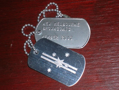 NMB Dog Tags on wood