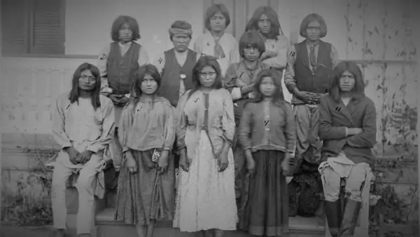 Portrait of a group of young Apache people as they attend a boarding school.