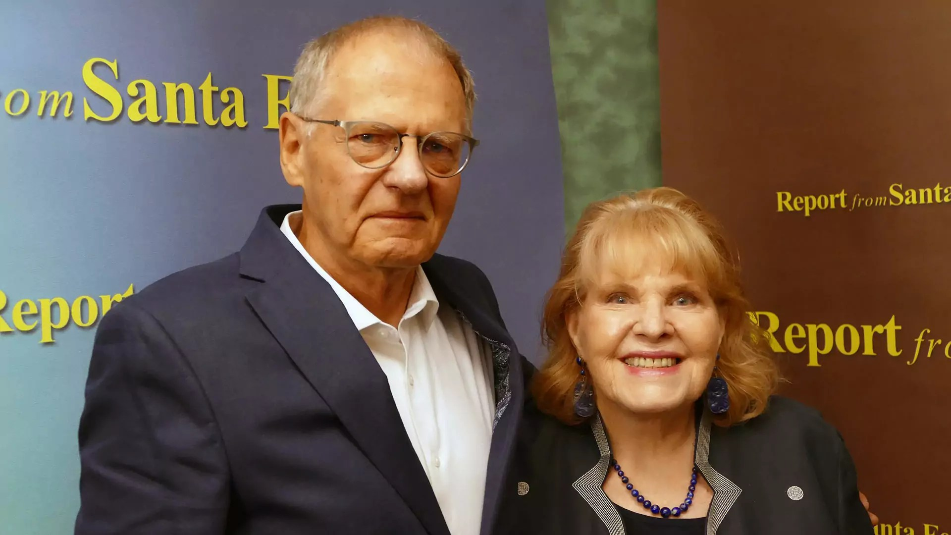 Michael McGarrity (left) and Lorene Mills (right) pose for a photo.