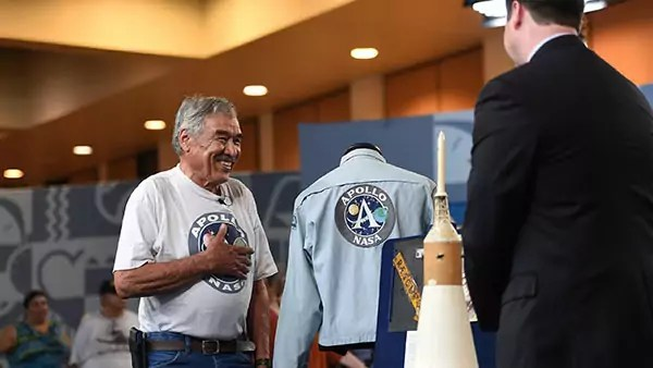 A man shows his NASA Apollo memorabilia at the Antiques Roadshow.