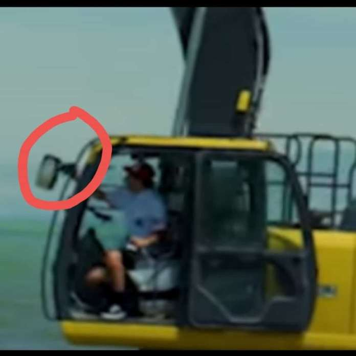 Screenshot of Jeff Wittek's Patreon video shows David Dobrik sitting on the driving seat of the excavator while holding the gears with one hand