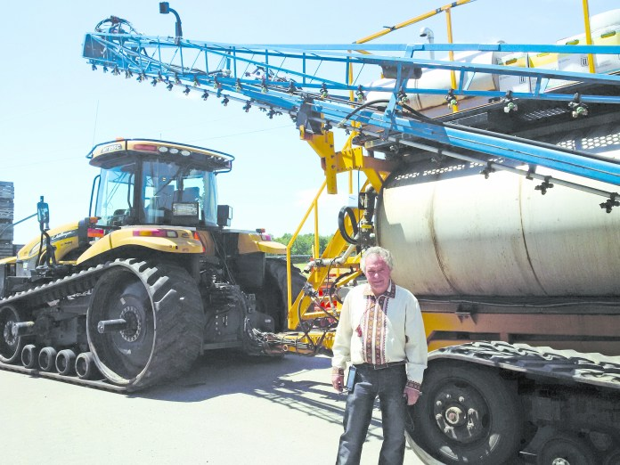 Borys Horodynsky in front of the 3,000-gallon sprayer