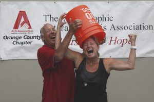 Ralph Rodheim helps Arts Commissioner Lyn Selich take the Ice Bucket Challenge in August 2014