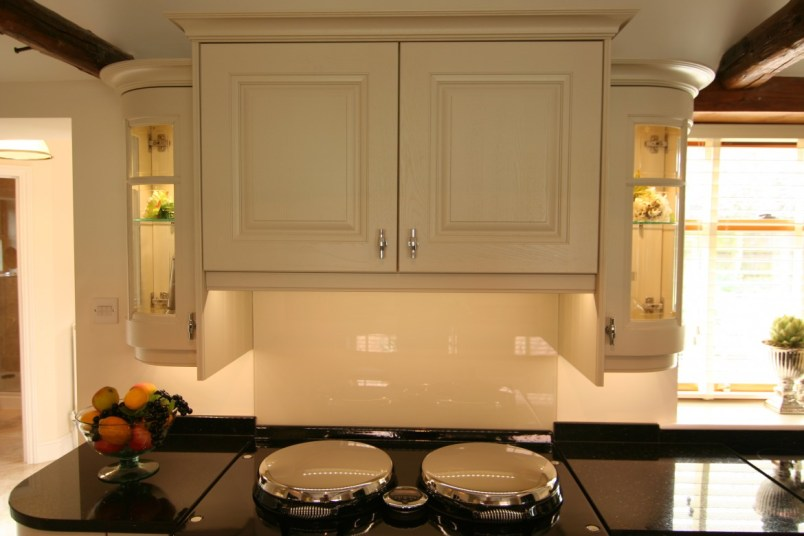 Painted raised panel doors in Cornell Almond above electric Aga