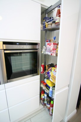 Pull out larder unit in handleless white gloss