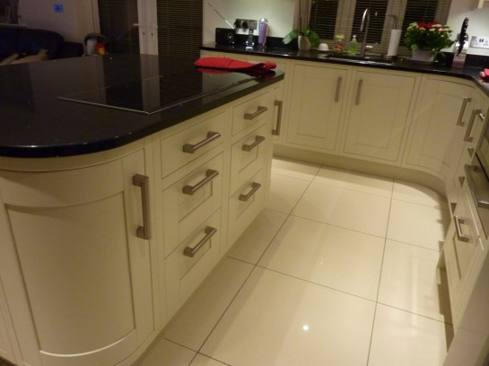 In-frame painted timber doors with bar handles in stainless steel