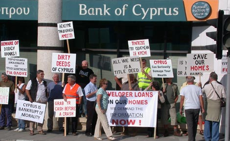 Protestors gather outside the Bank of Cyprus in Paphos